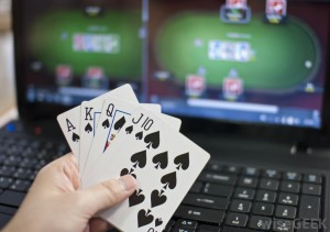 online-gambling-game-with-man-holding-cards