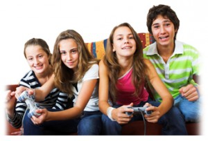 Young teens having fun at home, playing video games