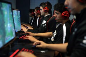 Austin Stadler, center, of Robert Morris University's varsity video gaming team, practices in Chicago on Monday, Oct. 13, 2014, in advance of their first competition. (Terrence Antonio James/Chicago Tribune/MCT)